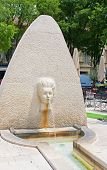 Fountain Carved As A Female Face In Nimes, France