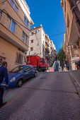 Barcelona, Spain - Feb 7, 2014: Baixada De La Gloria Street Leading To Famous Park Guell Entrance On