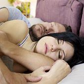 Happy Couple Sleeping Hugging