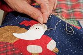 Sewing Santa's Eyes