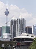 image of kuala lumpur skyline  - Kuala Lumpur skyline with a light rail station in the foreground and there Menara Kuala Lumpur Tower in the background - JPG