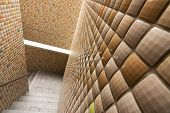Mosaic texture wall with stairs.