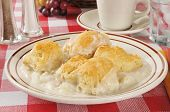 stock photo of biscuits gravy  - A casserole with white meat chicken mashed potatoes and biscuits - JPG