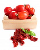 Sun dried tomatoes, fresh tomatoes in wooden box,  basil leaves, isolated on white