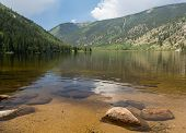foto of cottonwood  - Cottonwood lake in the valley before pass over mountains on clear calm day with the lake stretching off to distance - JPG