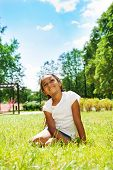 Portrait of black girl in park dreaming on lawn
