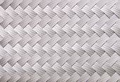 Image of gray ribbon weaved pattern