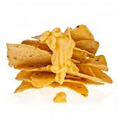 tower of chip nacho snack with cheese sauce isolated on white background