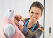 Portrait Of Smiling Tailor Woman Working In Studio