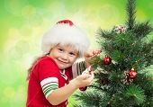 Pretty Preschool Girl Decorating Christmas Tree Isolated On White