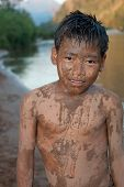picture of ou  - Boy of Asia with sand in the face at Nam Ou River in Laos - JPG