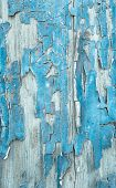 Old Patterned Wooden Background In Turquoise Or Blue With Flaked Color.