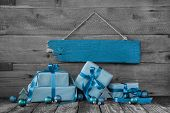 Background: Christmas Voucher Or Coupon With Presents In Turquoise Blue.