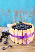 Tasty cake Charlotte with blueberries on wooden table