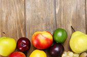 Assortment of juicy fruits on wooden background