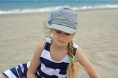 pic of squinting  - Cute little girl squinted on the beach - JPG
