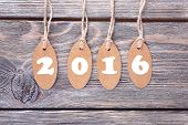 New year tags on wooden background