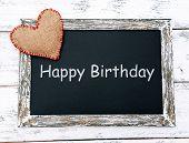 Happy birthday written on chalkboard, close-up