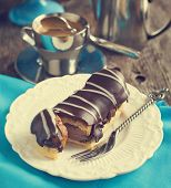 Chocolate Eclairs And Cup Of Espresso.