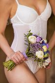 Bride In A White Underwear With A Wedding Bouquet Of Beautiful Flowers