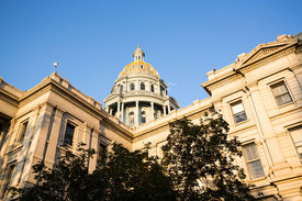 picture of granite dome  - The gold leaf covered dome of the State Capitol Dome in Denver Colorado shortly after sunrise - JPG