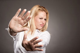 stock photo of disapproval  - unhappy young woman with disapproval expression - JPG