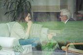 Elder Therapist Consulting Patient