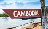 Cambodia wooden sign with a lake background