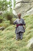 Farmer Proudly Shows Fresh Hay Near Karimabad