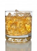 Closeup of a glass of whiskey and crushed ice isolated on white with reflection.