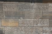 Deutschland (Germany). Word carved into the stone blocks.