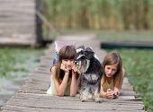 Girls With Dog On Dock
