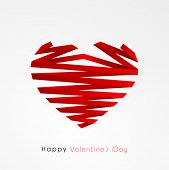 Creative heart shape made by red paper stripe on grey background for Happy Valentines Day celebration.
