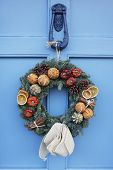 Homemade Christmas Wreath Hanging On Blue Door