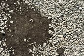 Crushed Stones Partly Covered With New Asphalt Concrete