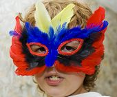 Boy In Carnival Mask