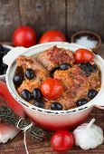 rabbit with tomatoes, olives and thyme