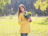 Beautiful Woman In Sunny Autumn Day