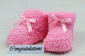 Congratulations card with pink baby booties