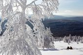 stock photo of ural mountains  - Snowmobile stands in deep snowdrifts of the mountains of the Southern Urals - JPG