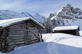 Cold winter with farm houses in the Alps