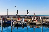 Piran harbor with symbolic statues of Tartini theatre, Istria