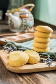Cookies On Woven Fabric On Wooden Tray