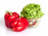Two large red paprikas and bunch of fresh salad
