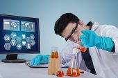 Scientist Working With Chemical In Laboratory