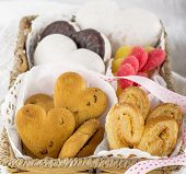 Assorted cookies in the shape of hearts a wicker basket