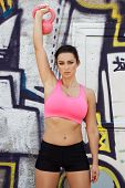 Sporty Woman With Pink Kettlebell
