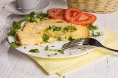 Omelet With Cheese And Fresh Herbs On The Table