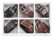 Leather Belts In Wooden Storage Box