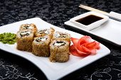 California Rolls Sushi With Pickled Ginger,vasabi And Soy Sauce
